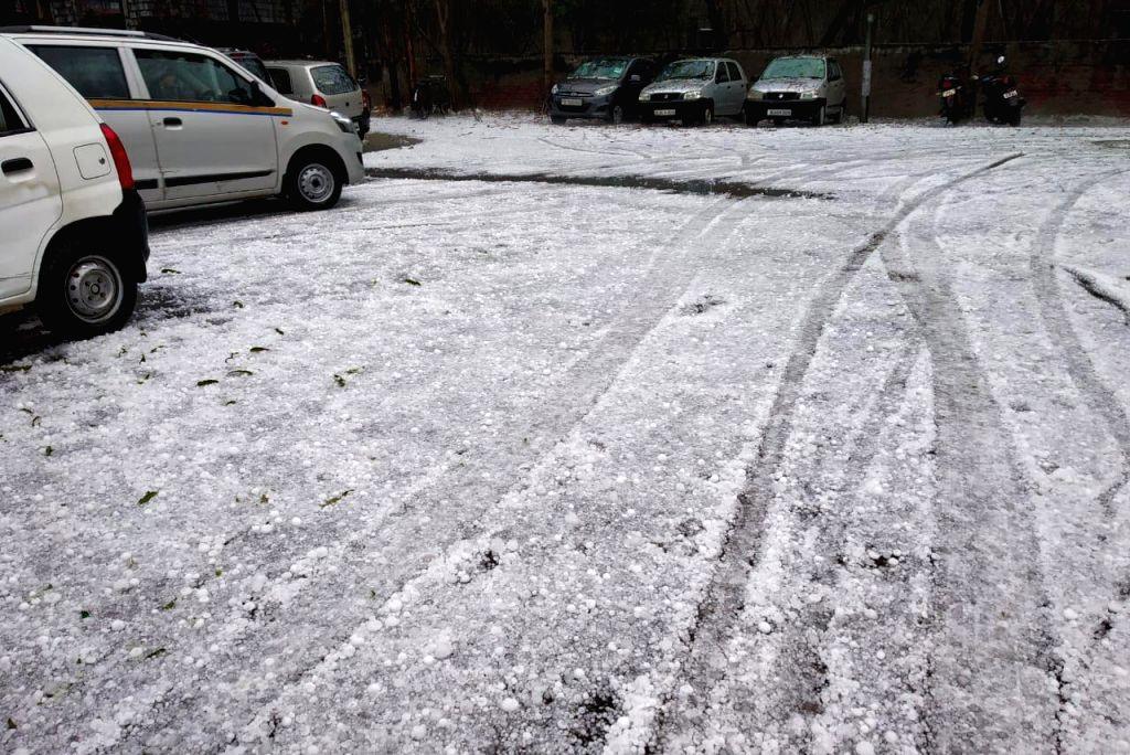 Noida: Rains accompanied by hailstorm hits Noida and adjoining areas on Feb 7, 2019. (Photo: IANS)