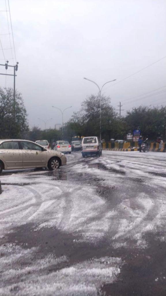 Noida: Rains and hailstorm hits Noida and adjoining areas on Feb 7, 2019. (Photo: IANS)