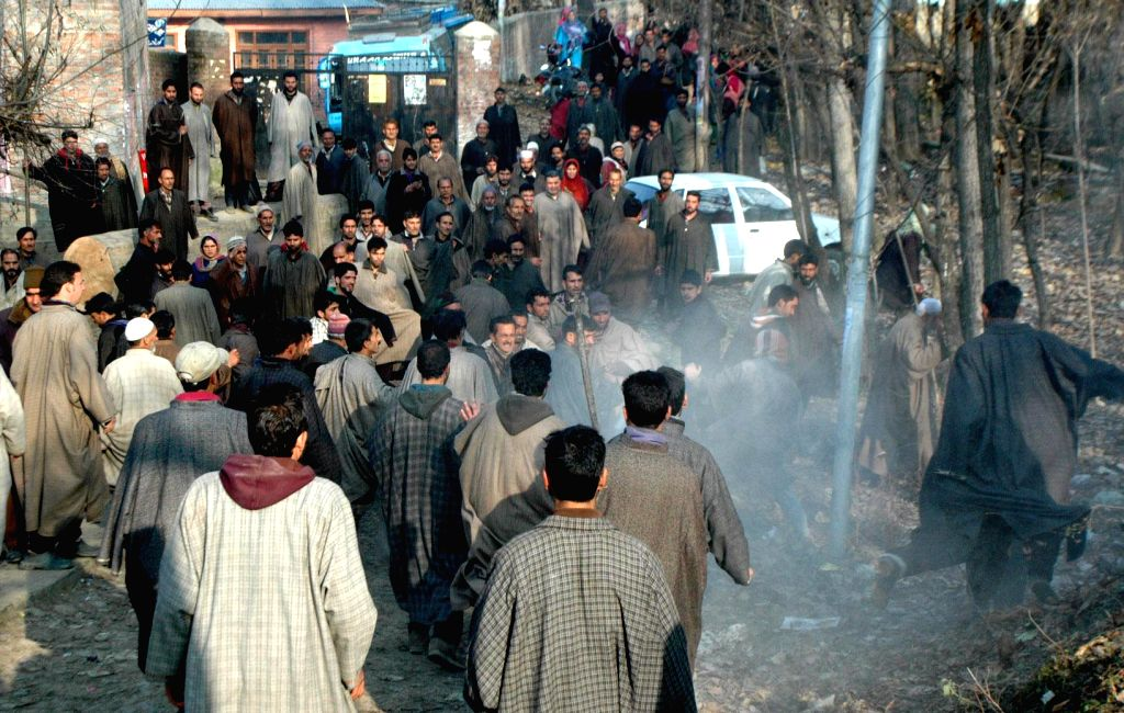 National Conference  (NC) and Peoples Democratic Party (PDP) supporters clash outside a polling booth in Khorbatpora village of Noorabad assembly constituency during the second phase of ...