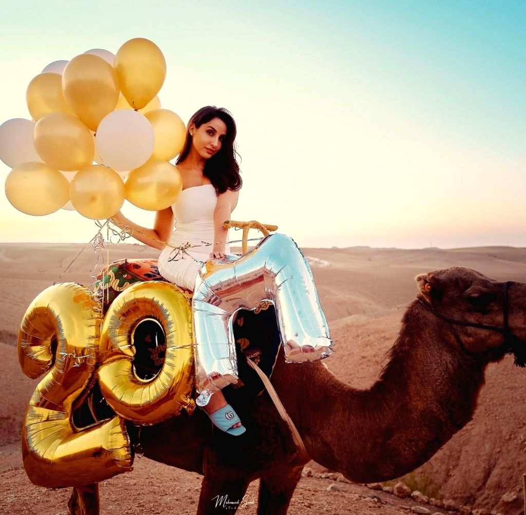 Nora Fatehi rides a camel to celebrate 20 Million Instagram followers.