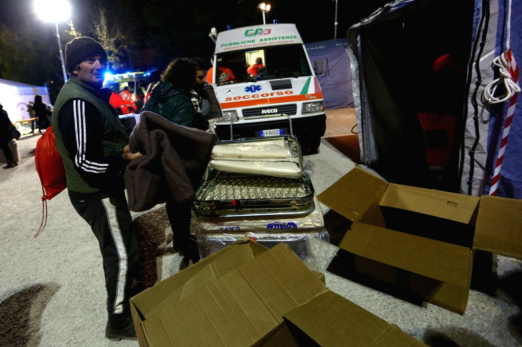 NORCIA, Oct. 31, 2016 - A resident receives a blanket at the relief camp in Norcia, central Italy, on Oct. 30, 2016. A 6.5-magnitude earthquake hit central Italy on Sunday, causing no victims, but ...