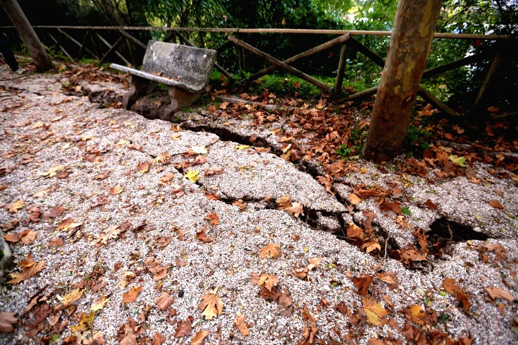 NORCIA, Oct. 31, 2016 - Photo taken on Oct. 30, 2016 shows the cracks causing by earthquake on a road in Norcia, central Italy. A 6.5-magnitude earthquake hit central Italy on Sunday, causing no ...