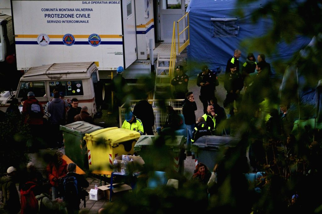 NORCIA, Oct. 31, 2016 - Rescue team, residents and journalists gather around the temporary command center in Norcia, central Italy, on Oct. 30, 2016. A 6.5-magnitude earthquake hit central Italy on ...