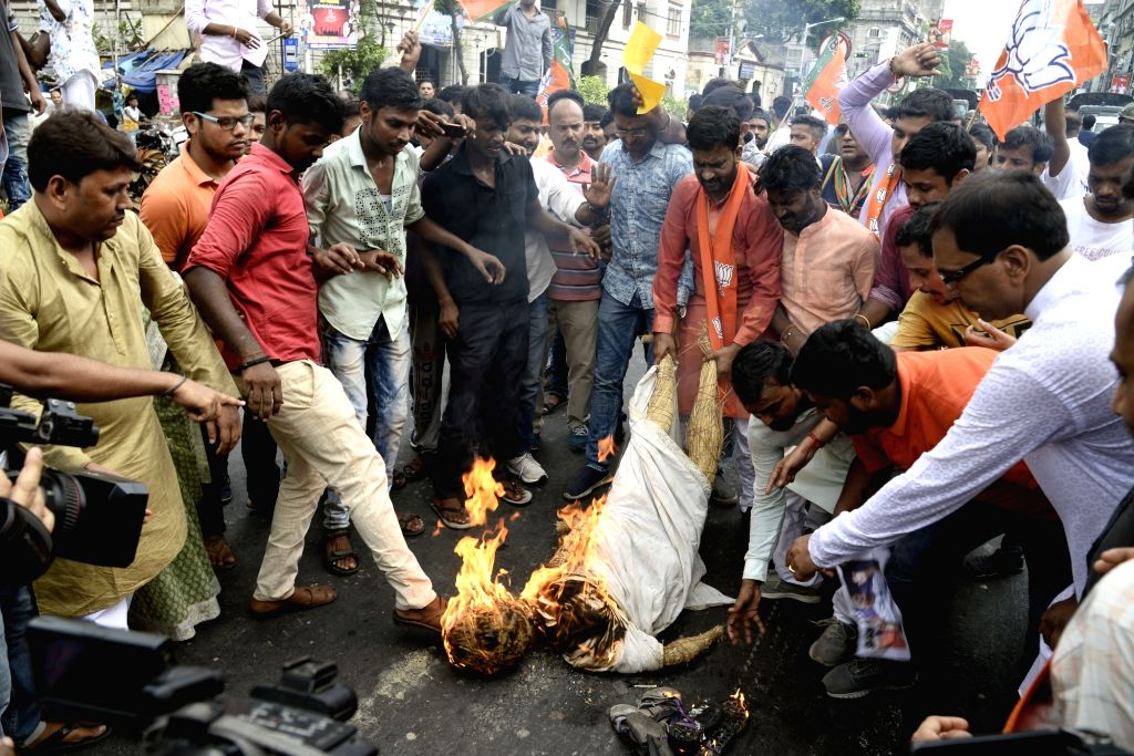 North 24 Parganas: BJP workers burn the effigy of West Bengal Chief Minister Mamata Banerjee while staging a demonstration against the alleged killing of  party workers during a clash between the ... - Mamata Banerjee