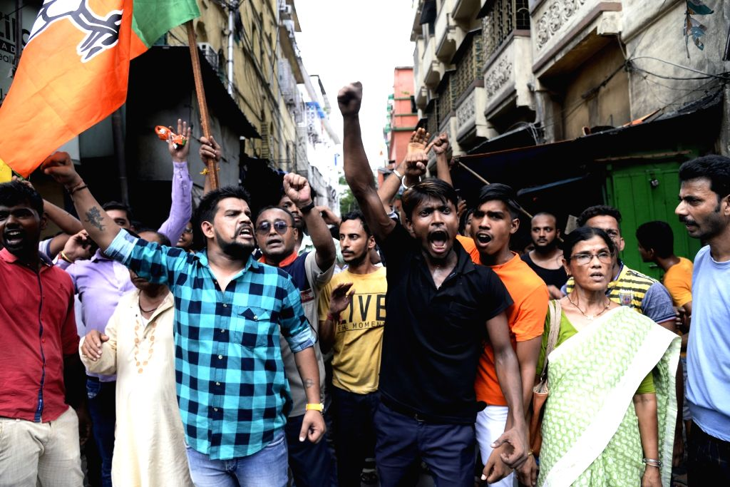 North 24 Parganas: BJP workers stage a demonstration against the alleged killing of  party workers during a clash between the saffron outfit and the ruling Trinamool Congress at Sandeshkhali, in West ...