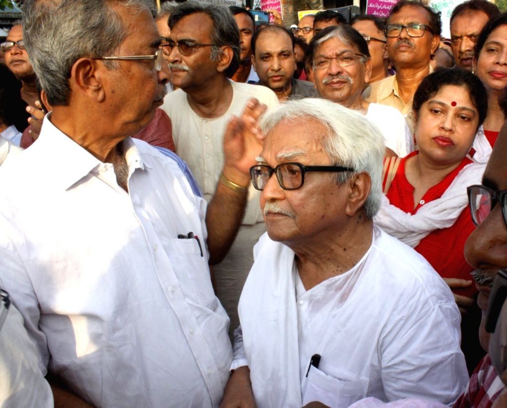 North 24 Parganas: CPI-M leaders Biman Bose, Surjya Kanta Mishra along with Congress's Somen Mitra during a peace rally in North 24 Parganas district's Bhatpara area on June 25, 2019. Bhatpara has been in news due to large-scale political violence fo - Biman Bose and Surjya Kanta Mishra
