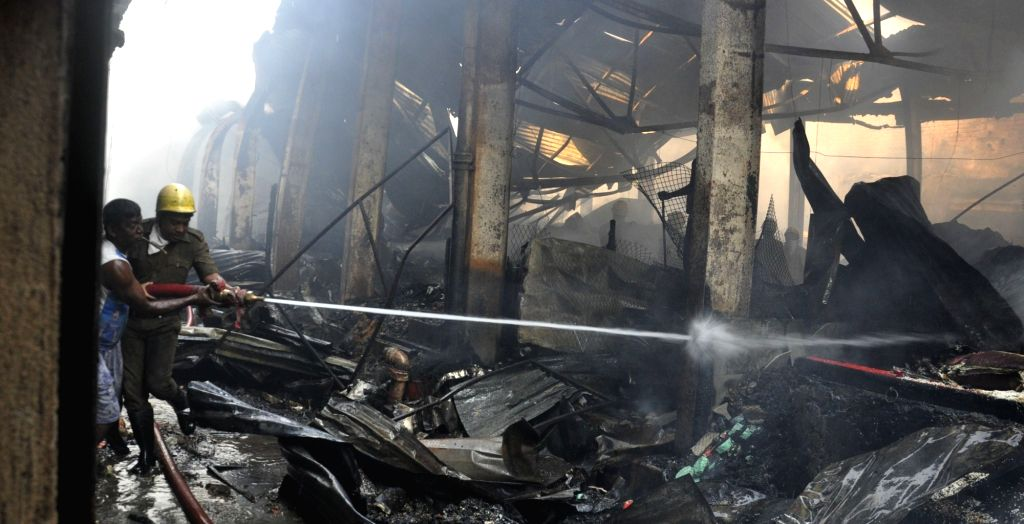 North 24 Parganas: Firefighters douse fire after a major fire broke out in a two-storeyed shopping complex in Dumdum Cantonment's Gora Bazar in in North 24 Parganas district of West Bengal ...