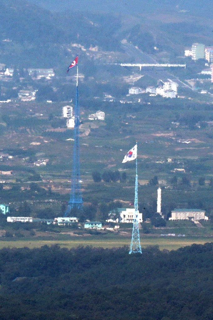 North Korea: In this photo taken from an observatory in the South Korean border city of Paju on Sept. 15, 2017, flags of South and North Korea fly in the South's Daeseong Village (lower) and the ...