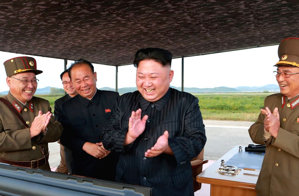 North Korea: North Korea leader Kim Jong-un (2nd from R) laughs and claps his hands after the launch of the Hwasong-12 intermediate-range ballistic missile in this photo released by the North's ...