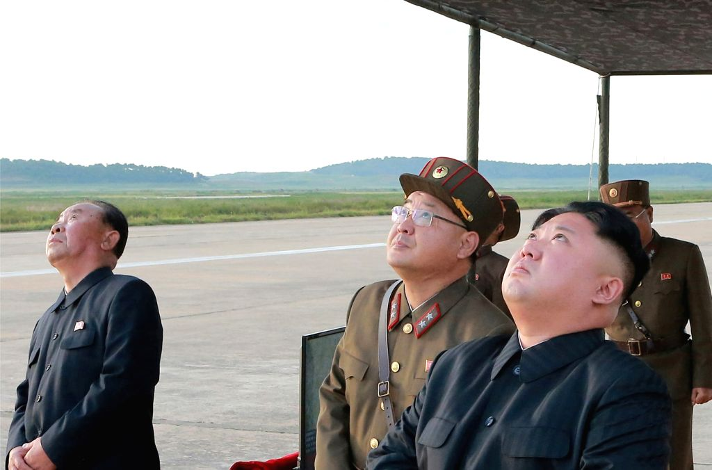 North Korea: North Korean leader Kim Jong-un (R) watches the launch of the Hwasong-12 intermediate-range ballistic missile in this photo released by the North's official Korean Central News Agency on ...