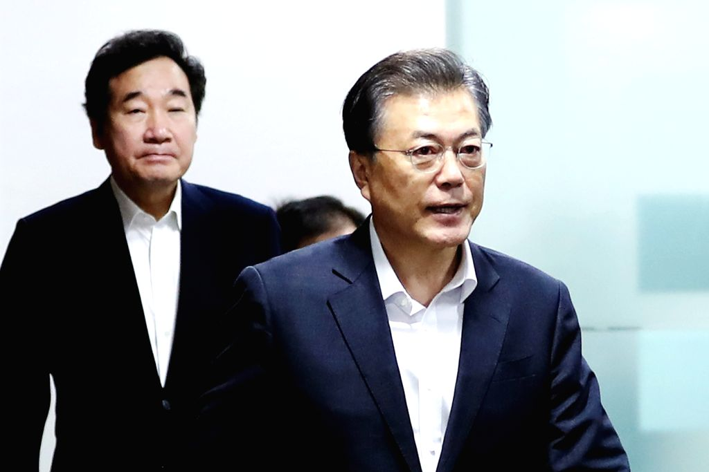 North Korea: President Moon Jae-in (front) and Prime Minister Lee Nak-yon arrive for a National Security Council meeting on Sept. 15, 2017, to discuss North Korea's missile launch earlier in the day ... - Lee Nak