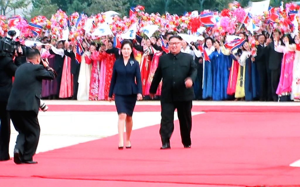 North Korea's leader Kim Jong-un (R) and his wife, Ri Sol-ju, head to South Korea's presidential jet at Pyongyang International Airport to welcome South Korean President Moon Jae-in on Sept. ...