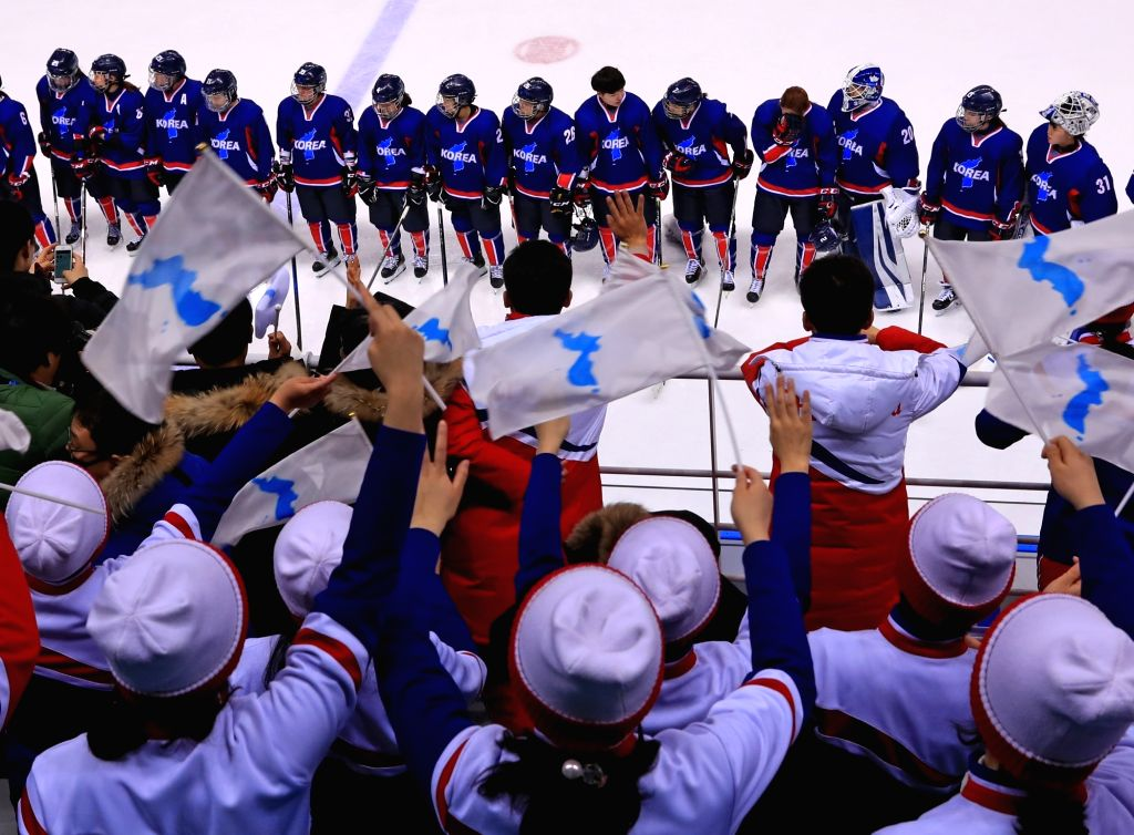 North Korean cheerleaders respond as the South-North Korean joint women's ice hockey team acknowledges the crowd after a PyeongChang Winter Olympics match against Japan at the Kwandong ...