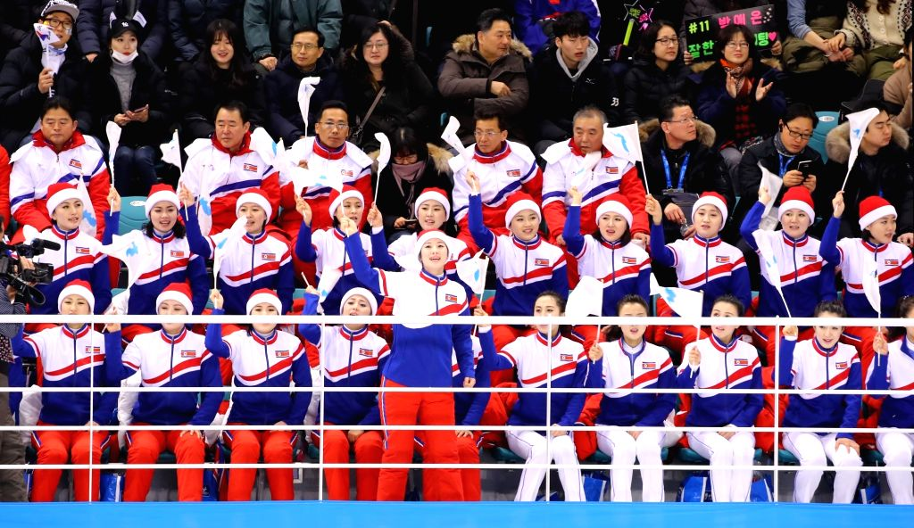 North Korean supporters root for the unified Korean team in a women's preliminary round ice hockey game with Sweden at the PyeongChang Winter Olympics at the Kwandong Hockey Centre in ...