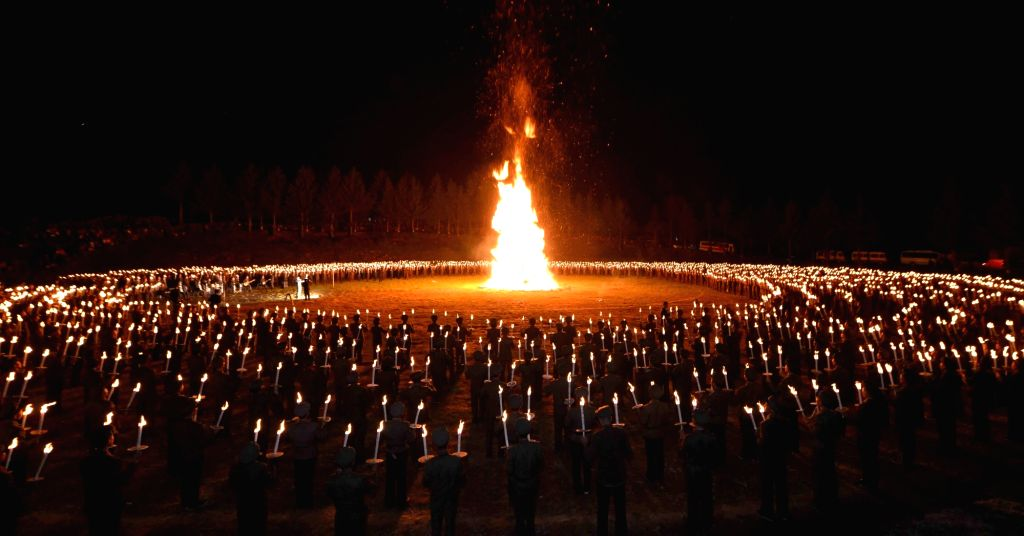 North Korean youths hold a torchlight procession and campfire meeting at Pochonbo, in the northern Ryanggang Province, to mark the 80th anniversary of a key battle against Japanese colonial forces in ...
