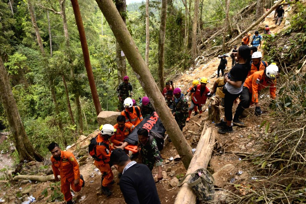 NORTH SULAWESI, March 1, 2019 (Xinhua) -- Members of Indonesian Search and Rescue (SAR) team pull out a body of a gold miner after an unlicensed gold mine collapsed at Bolaang Mongondow district of North Sulawesi province, Indonesia, Feb. 28, 2019. R