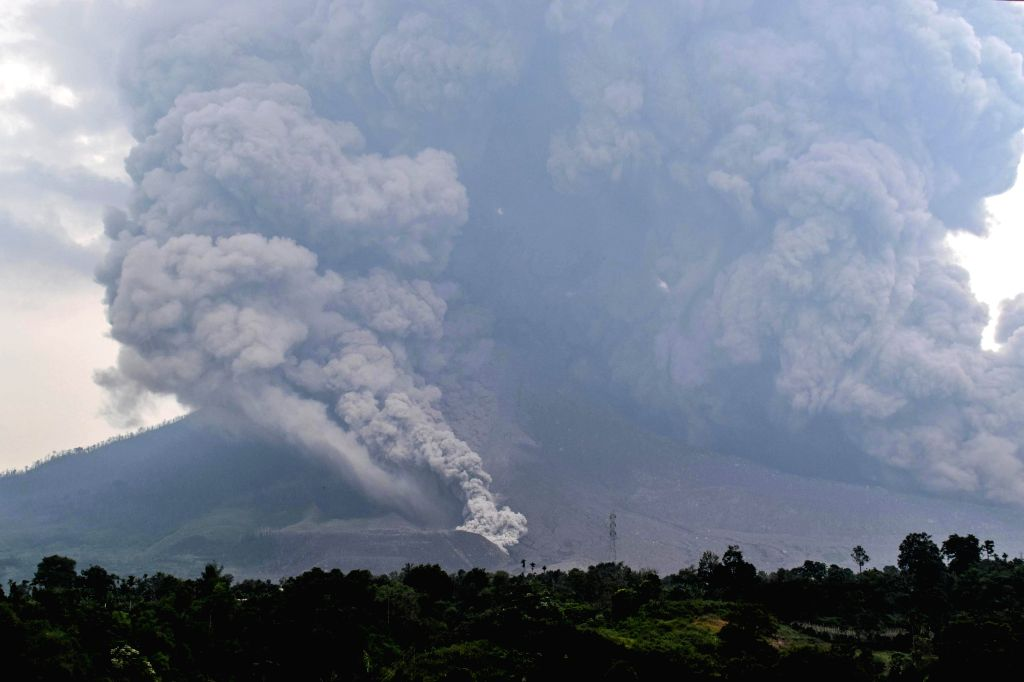NORTH SUMATERA, April 7, 2018 - Photo taken on April 6, 2018 shows Mount Sinabung volcano spewing thick volcanic ash, seen from the town of Karo, North Sumatera, Indonesia.
