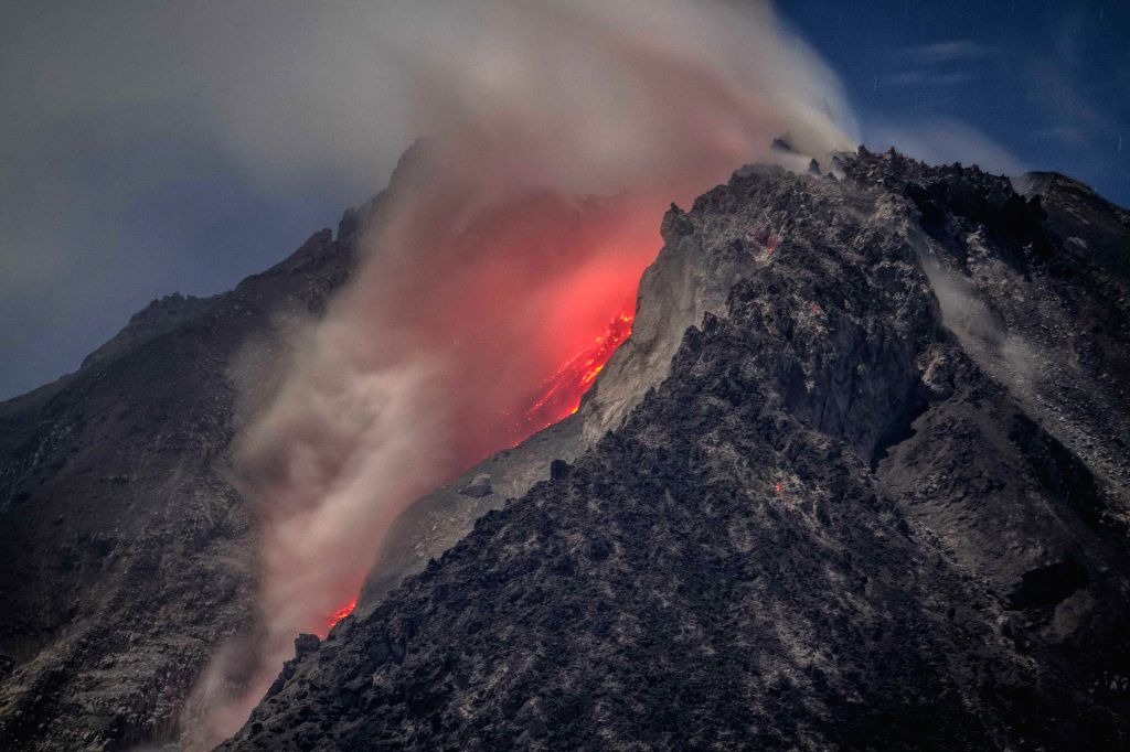 The long exposure photograph taken before dawn on April 4, 2015 shows scorching lava flow and giant ash clouds released from the crater during the eruption of ...