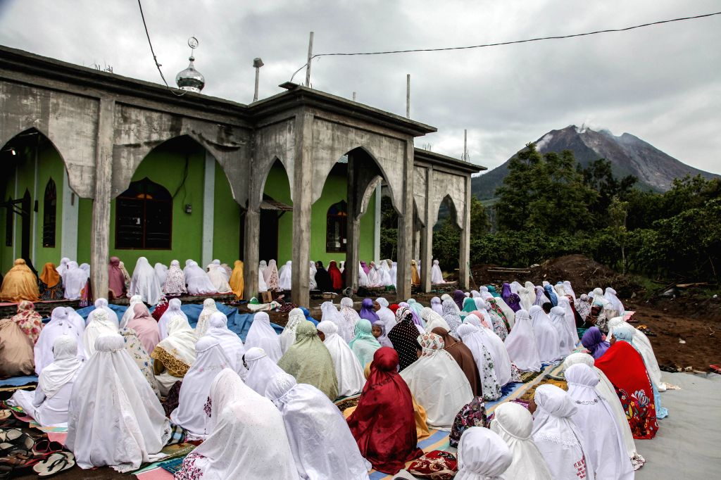 NORTH SUMATRA, Aug. 11, 2019 - Indonesian Muslims pray to celebrate the festival of Eid al-Adha near Mount Sinabung in Karo, North Sumatra, Indonesia, Aug. 11, 2019.