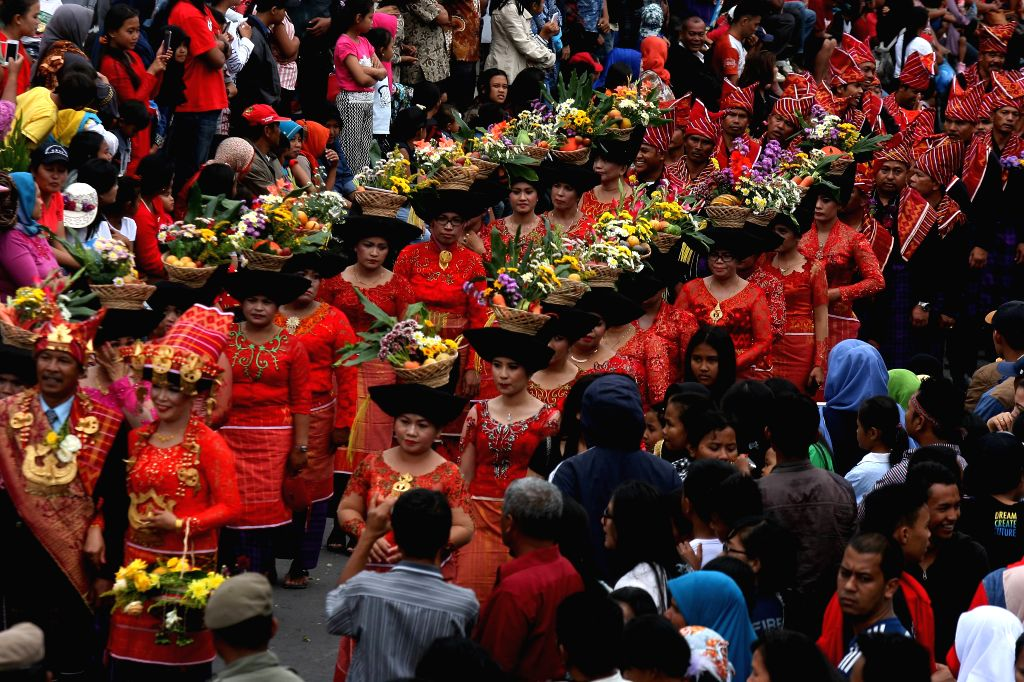 NORTH SUMATRA, July 6, 2017 - Women wearing baskets decorated with flower and fruits are seen during Fruits and Flowers Festival in Berastagi, North Sumatra, Indonesia, on July 6, 2017. The festival ...
