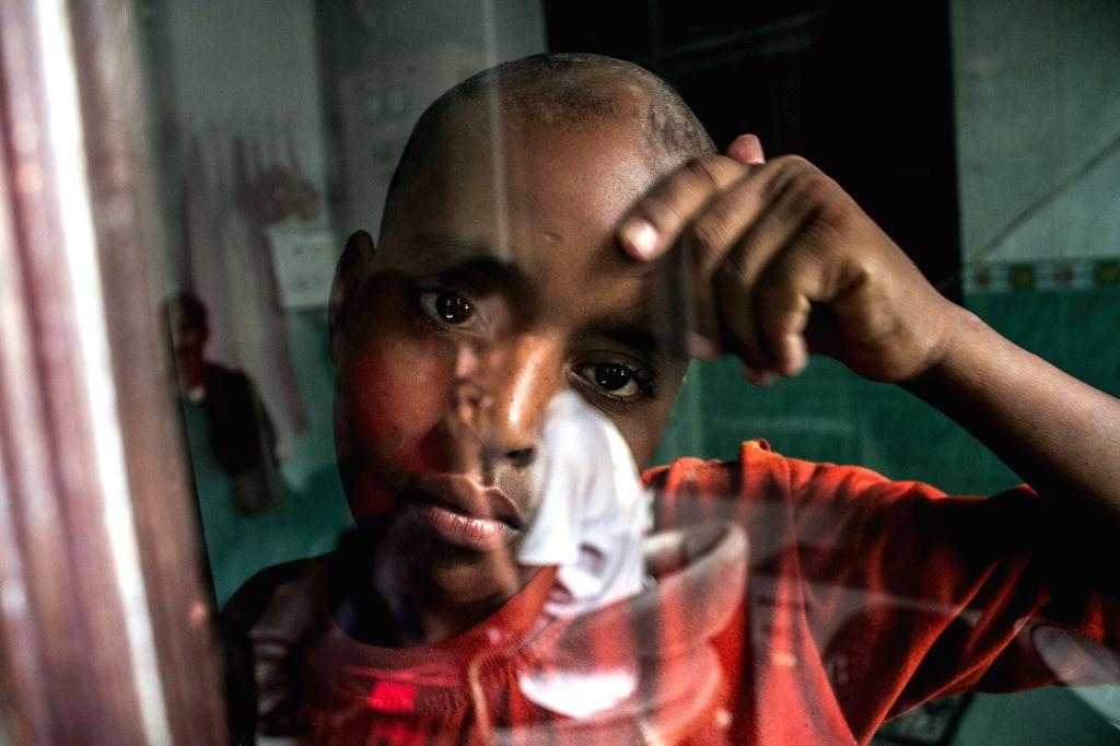NORTH SUMATRA, Nov. 25, 2016 - A Somali asylum seeker takes a rest at Medan Immigration office in Belawan, North Sumatra, Indonesia, Nov. 25, 2016. Indonesian authoirities arrested twenty-six asylum ...