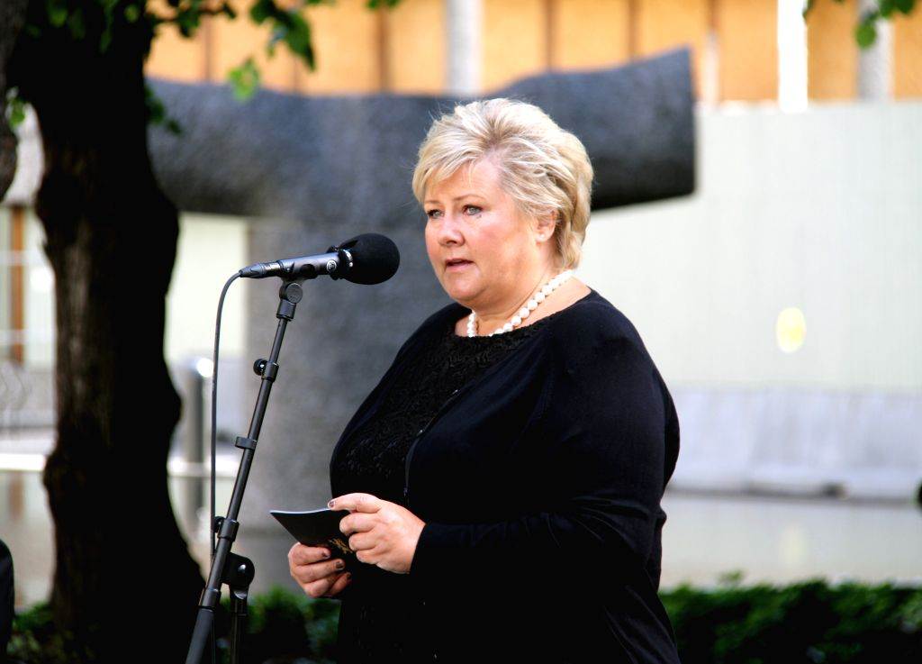 Norway's Prime Minister Erna Solberg addresses a wreath-laying ceremony in front of the damaged government building which used to house the office of Norway's prime ... - Erna Solberg