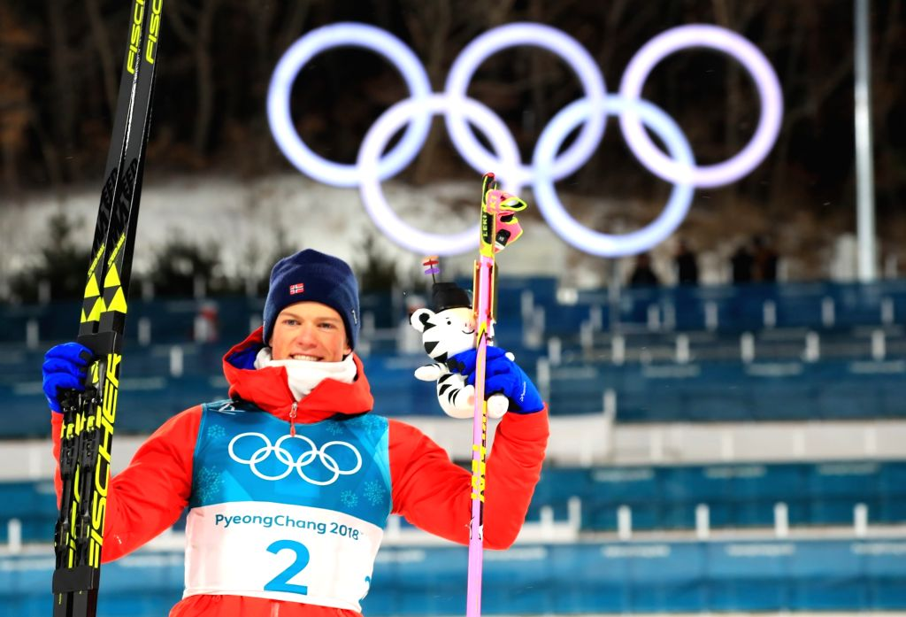Norwegian cross-country skier Johannes Klaebo celebrates during the flower ceremony after winning gold in the men's sprint classic final of the PyeongChang Winter Olympics at Alpensia ...