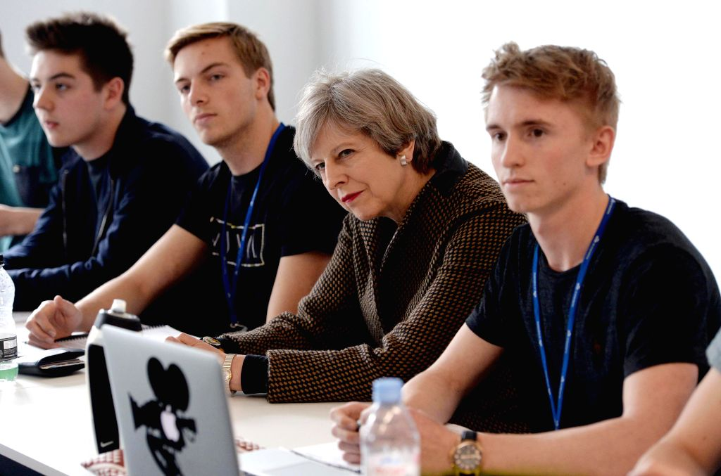 NORWICH, May 9, 2017 - Theresa May (2nd R), British prime minister and leader of the Conservative Party, attends an election campaign at the International Aviation Academy in Norwich May 8, 2017. ...
