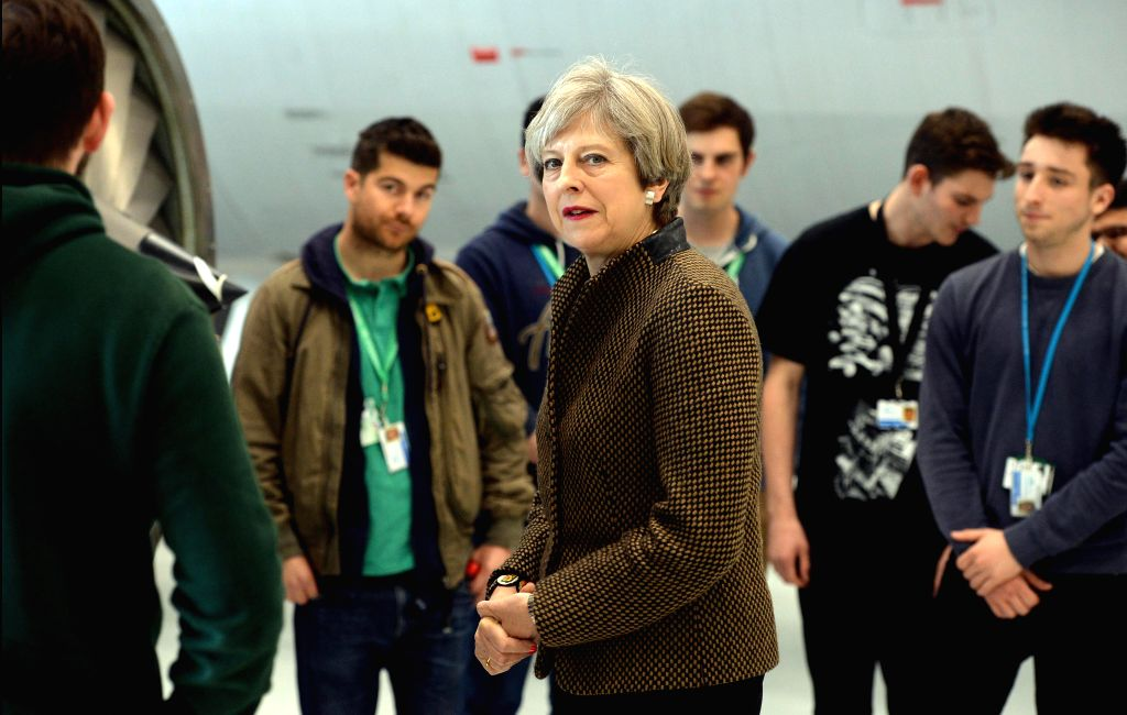 NORWICH, May 9, 2017 - Theresa May (C), British prime minister and leader of the Conservative Party, attends an election campaign at the International Aviation Academy in Norwich May 8, 2017. Britain ...