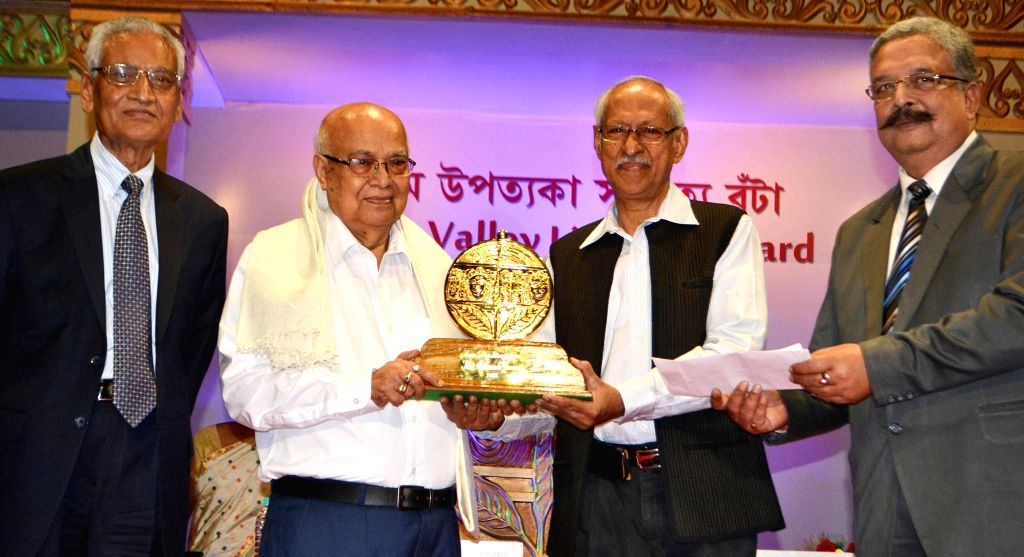 Noted Assamese Writer Atulananda Goswami receives  Assam Valley Literary Award 2013 from Eminent Novelist Damodar Mauzo during a programme at Machkhowa ITA Center in Guwahati on May 9, 2014.