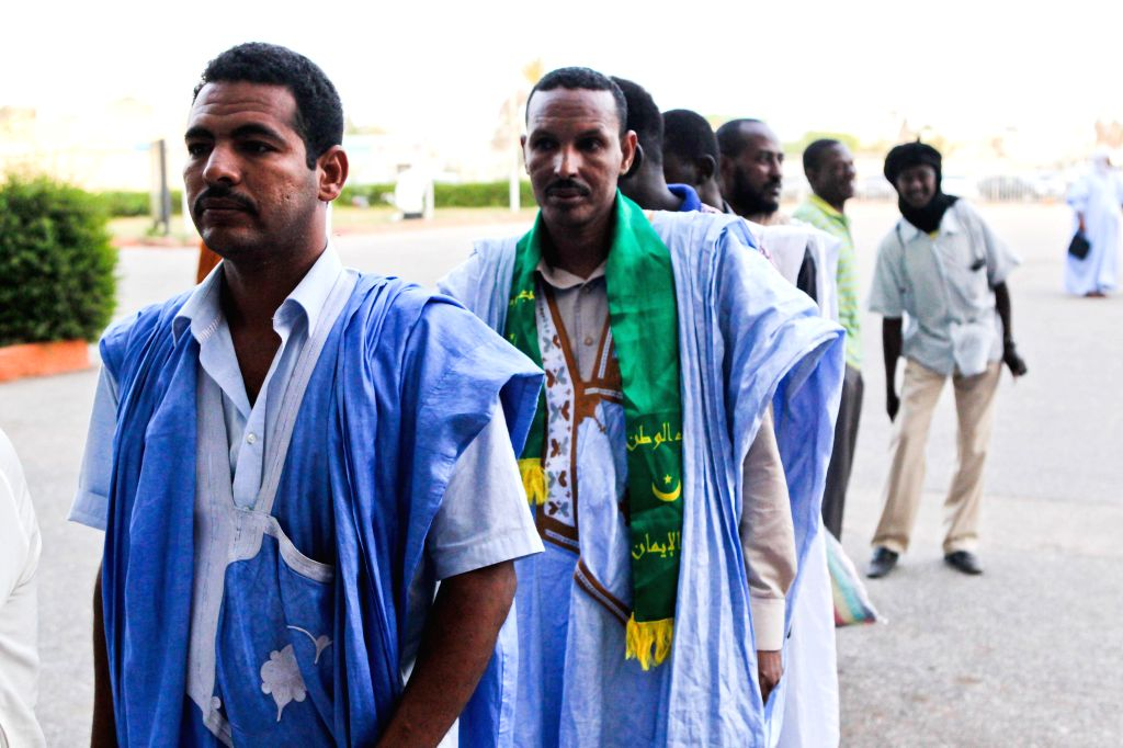 Voters queue up at a polling station in Olympic Stadium in Nouakchott, capital of Mauritania, June 21, 2014. More than 1.3 million voters are expected to choose .