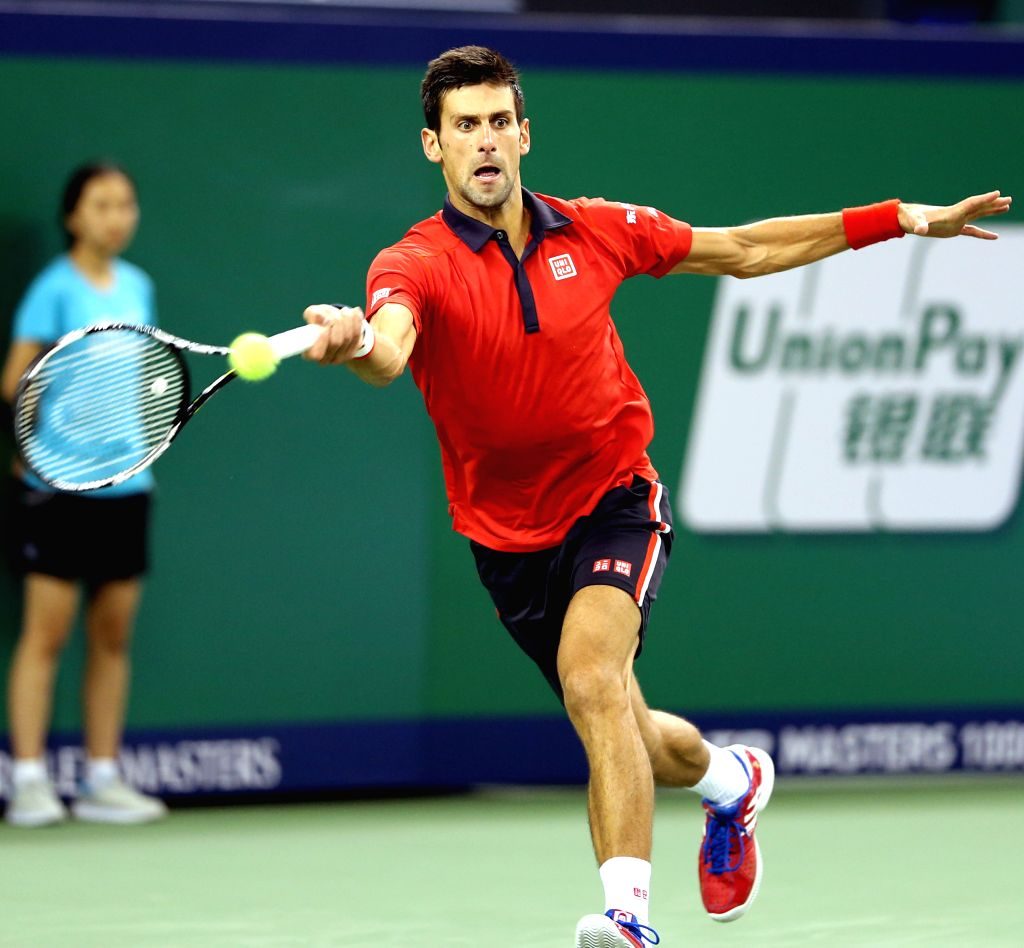 Novak Djokovic of Serbia hits a return during his men's singles semi-final match against Andy Murray of Britain at the Shanghai Masters tennis tournament in ...