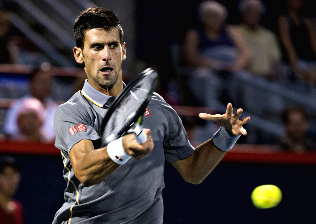 Novak Djokovic of Serbia hits a return to Ernests Gulbis of Latvia during the quarterfinal match at the Rogers Cup in Montreal, Canada, on Aug. 14, 2015. Djokovic ...