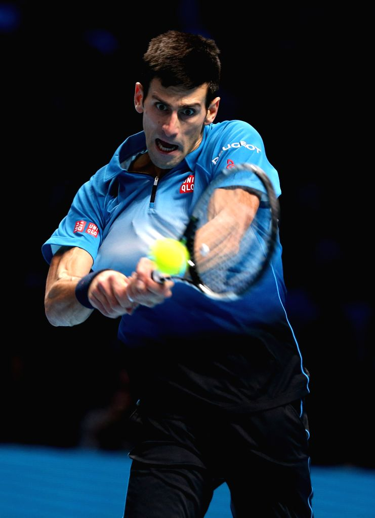 Novak Djokovic of Serbia returns a ball during the men's single's final against Roger Federer of Switzerland at the ATP World Tour Finals at the O2 Arena in London, ...