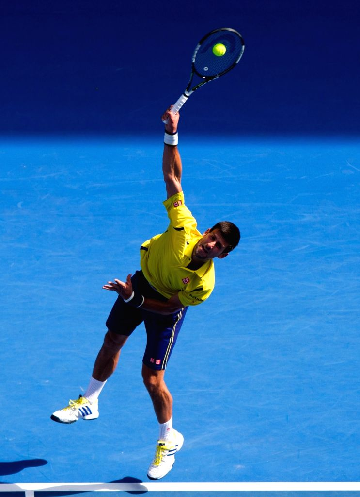 Novak Djokovic of Serbia returns the ball during the first-round match of men's singles of Australian Open Tennis Championships against Hyeon Chung of South Korea ...