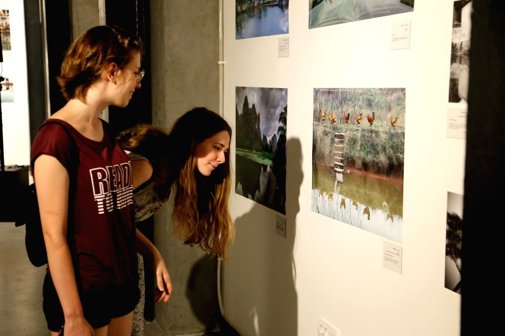 """NOVI SAD, July 22, 2019 - Visitors view photos during the photo exhibition """"Reflection in Water"""" in Novi Sad, Serbia, July 21, 2019. The changes in urban and rural China were presented to ..."""
