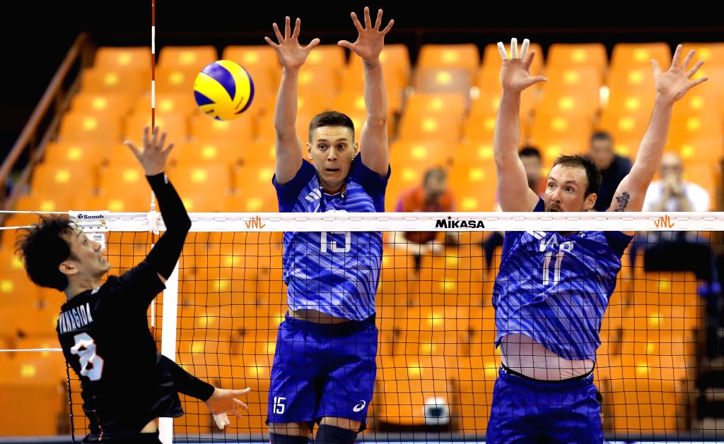 NOVI SAD (SERBIA), June 2, 2019 Japan's Masahiro Yanagida (L) vies with Russia's Victor Poletaev (C) and Igor Philippov during Volleyball Nations League match between Japan and Russia in ...