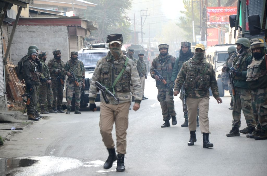 :Nowgam: Security personnel during combing operations after two militants were killed in a gunfight with the security forces in Sathu area of Jammu and Kashmir's Nowgam on Oct 24, 2018. ...