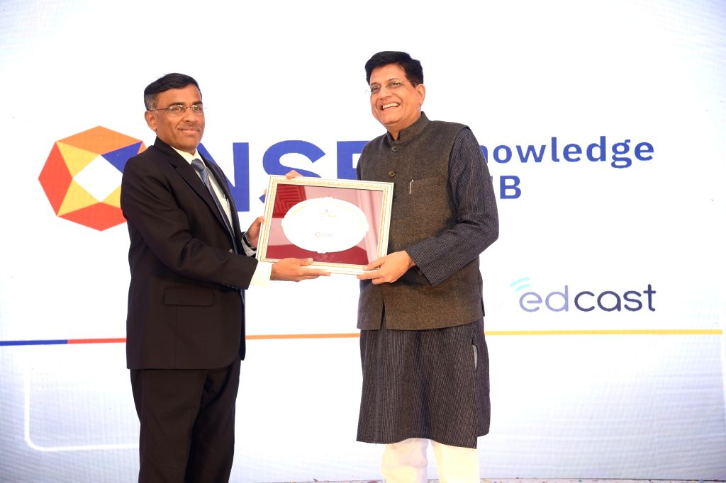 NSE MD & CEO Vikram Limaye presents a memanto to Union Minister for Commerce and Industry Piyush Goyal at the inauguration of The National Stock Exchange (NSE) Knowledge Hub in New ...