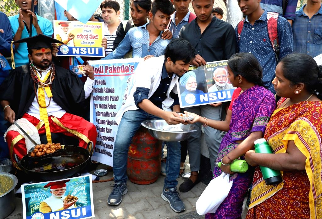 NSUI activists stage a demonstration against Prime Minister Narendra Modi in Bengaluru on Jan 30, 2018. - Narendra Modi