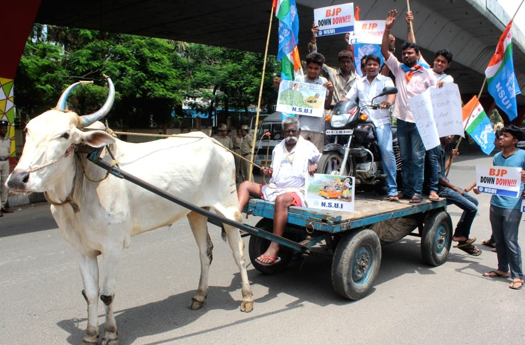 NSUI activists stage a demonstration against the central government for the recent hikes in petrol and gas prices in Bengaluru on June 3, 2016.
