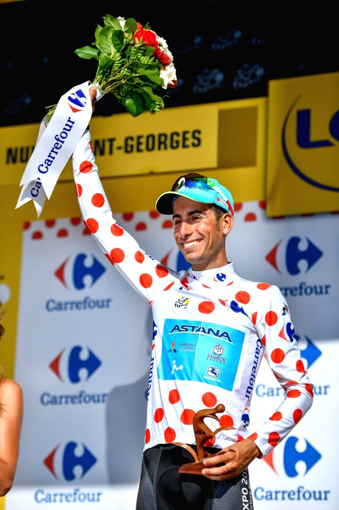 NUITS-SAINT-Astana Pro Team rider Fabio Aru of Italy celebrates on the podium wearing the best climber's polka-dot jersey after the 7th stage of the 104th Tour de ...