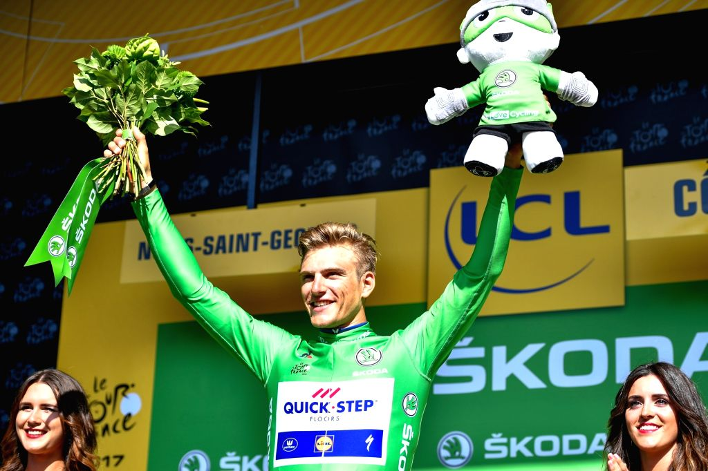 NUITS-SAINT-Quick Step Floors team rider Marcel Kittel (C) of Germany celebrates on the podium after winning the 7th stage of the 104th Tour de France cycling race ...