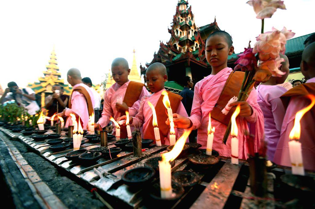 Nuns light candles on Myanmar's traditional Thadingyut lantern festival at the Shwedagon Pagoda in Yangon, Myanmar, on Oct. 28, 2015. The Thadingyut lantern festival ...