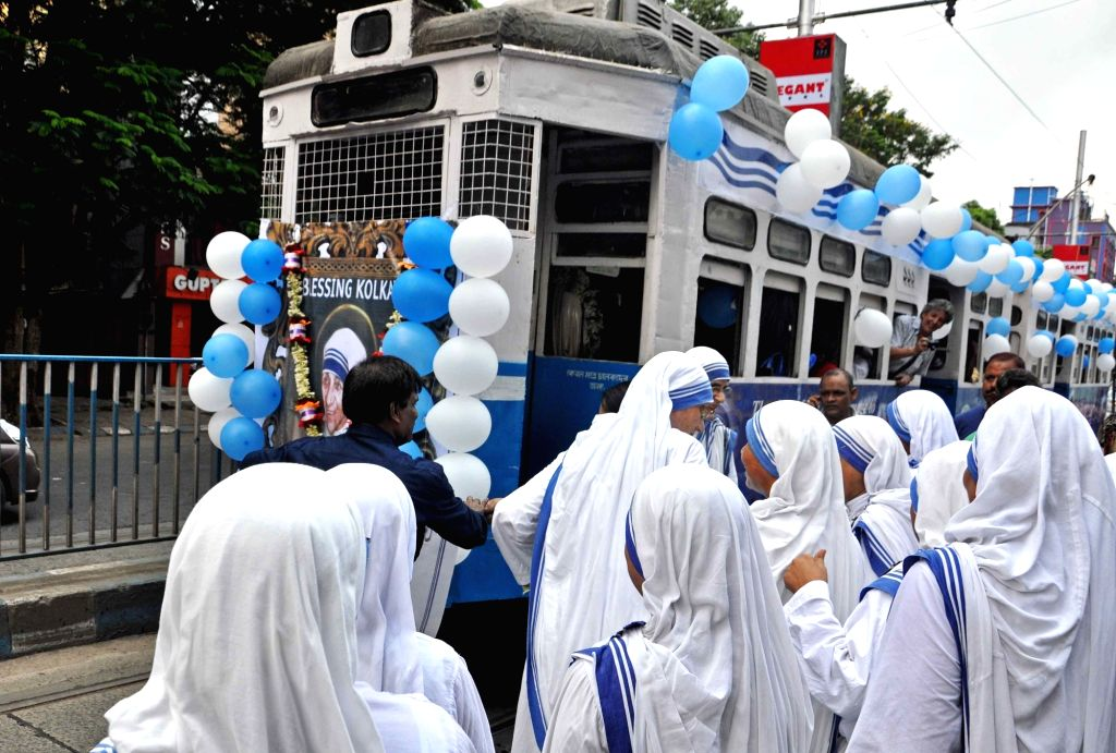 Nuns ride a tram decorated to pay tribute to Saint Teresa of Calcutta in Kolkata on Sept 18, 2016.