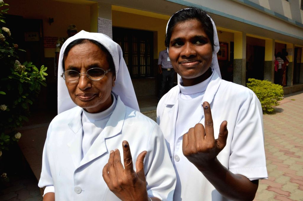 Nuns showing their finger marked with phosphorous ink after casting their vote during the third phase of Bihar assembly polls in Patna on Oct 28, 2015.