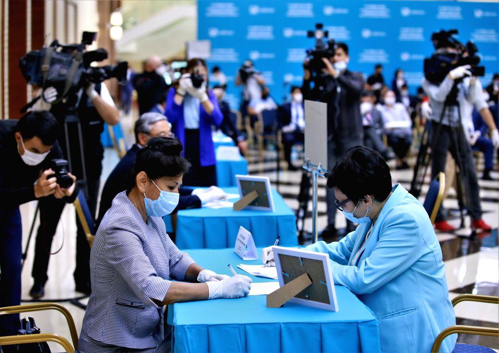 Nur-A voter registers for the Senate election at a polling station in Nur-Sultan, Kazakhstan, on Aug. 12, 2020. Kazakhstan's Central Election Commission (CEC) on ...