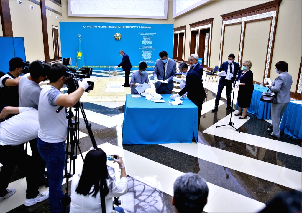 Nur-Staff of Kazakhstan's Central Election Commission collect ballots for the Senate election at a polling station in Nur-Sultan, Kazakhstan, on Aug. 12, 2020. ...