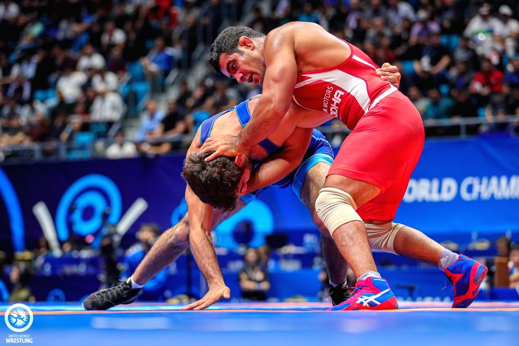 Nur-Sultan: India's Sushil Kumar in action against Azerbaijan's Khadzhimurad Gadzhiyev in the first-round bout in the 74-kg freestyle category at the ongoing World Wrestling Championships in ... - Sushil Kumar