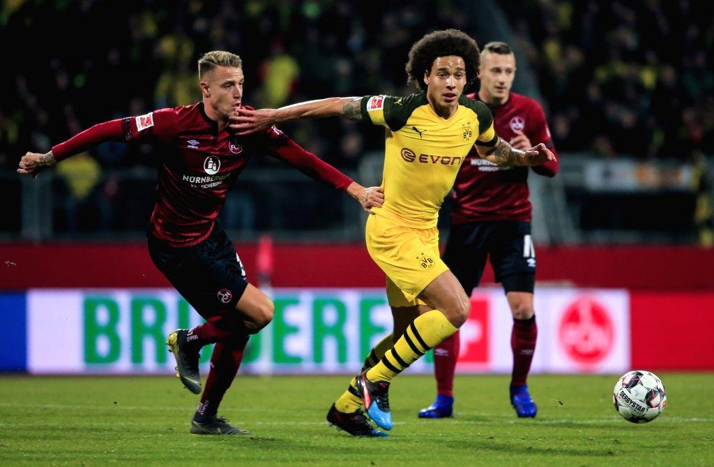 NUREMBERG, Feb. 19, 2019 - Dortmund's Axel Witsel (C) vies with Nuremberg's Ondrej Petrak during a German Bundesliga match between 1. FC Nuremberg and Borussia Dortmund in Nuremberg, Germany, Feb. ...